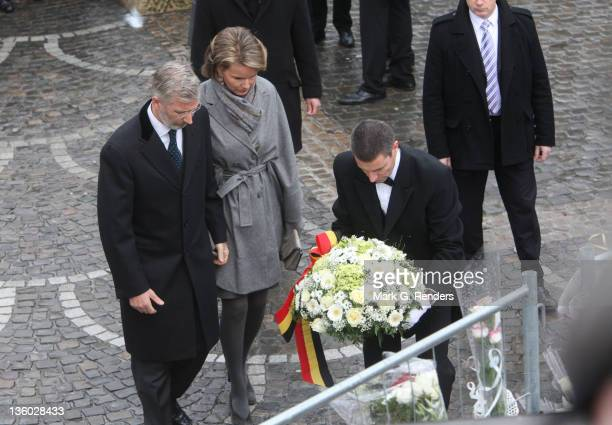 Princesss Mathilde and Prince Philippe of Belgium pay tribute to the victims of Place Saint Lambert, where Nordin Amrani killed five and injured over...