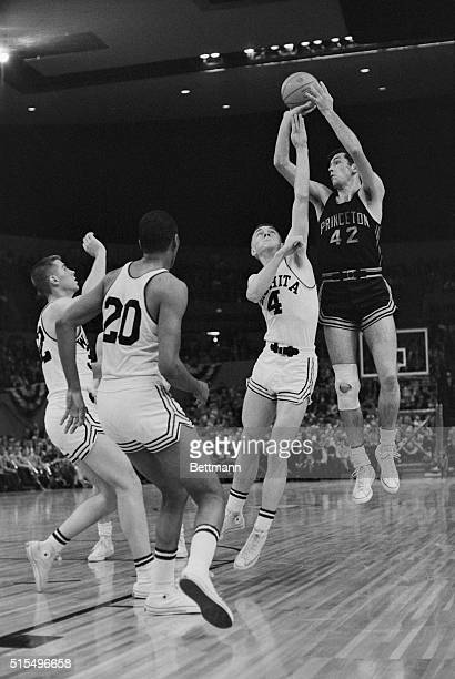 Princeton forward Bill Bradley rises above a defending Vernon Smith and fellow Wichita State defenders for a shot