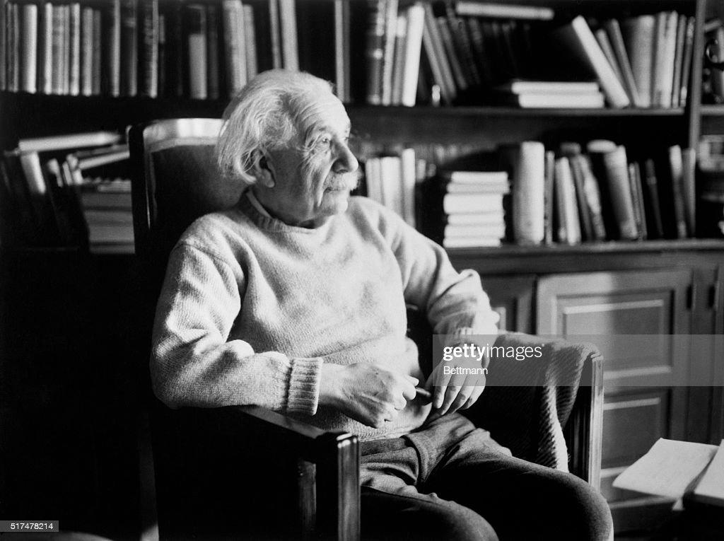Scientist Albert Einstein in Library : News Photo