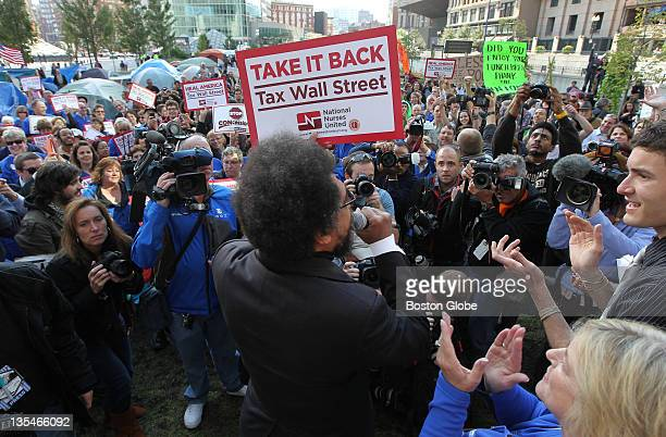 Princeton professor Cornel West and members of the MA Nurses Association including President Donna KellyWilliams lower right join Occupy Boston for...