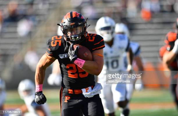 Princeton RB Ryan Quigley carries the ball for a touchdown in the second half during the game between the Columbia Lions and Princeton Tigers on...
