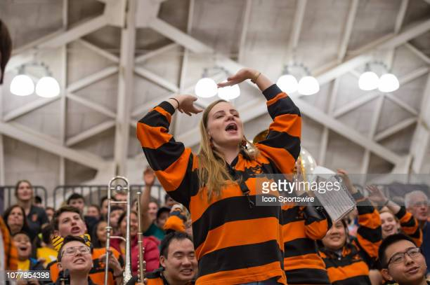Princeton Tigers band members cheer the team on during the second half of the college basketball game between the Penn Quakers and Princeton Tigers...