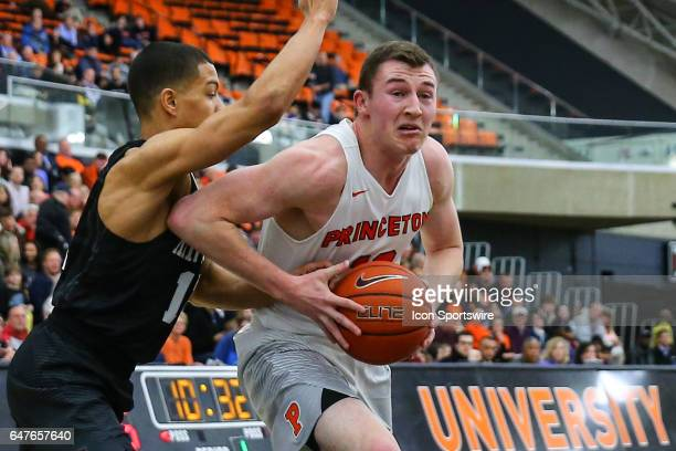 Princeton Tigers forward Spencer Weisz drives to the basket during the College basketball game between the Princeton Tigers and the Harvard Crimson...