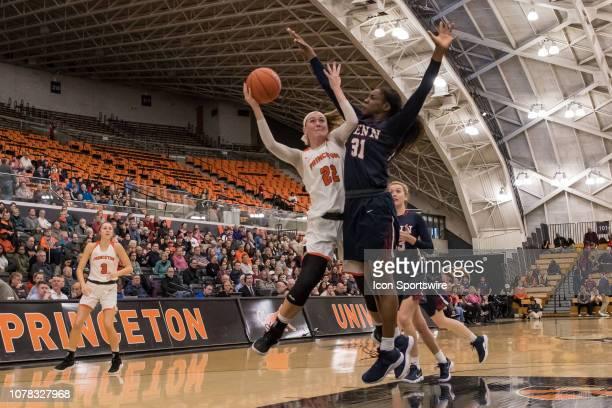 Princeton Tigers forward Taylor Baur shoots the ball during the second half of the college basketball game between the Penn Quakers and Princeton...