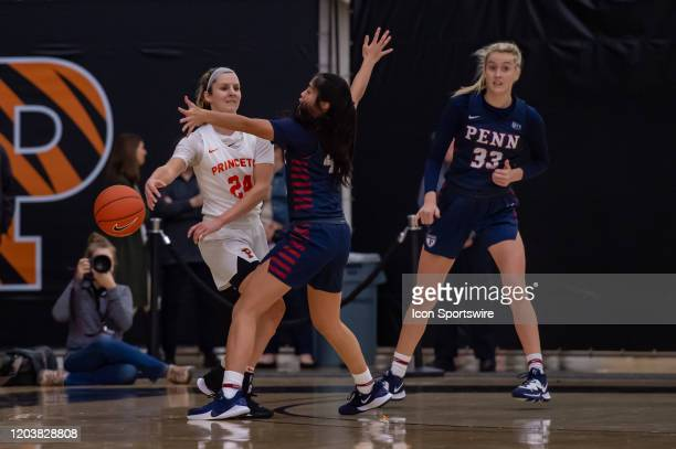 Princeton Tigers guard Julia Cunningham passes the ball during the Ivy League college basketball game between the Penn Quakers and Princeton Tigers...