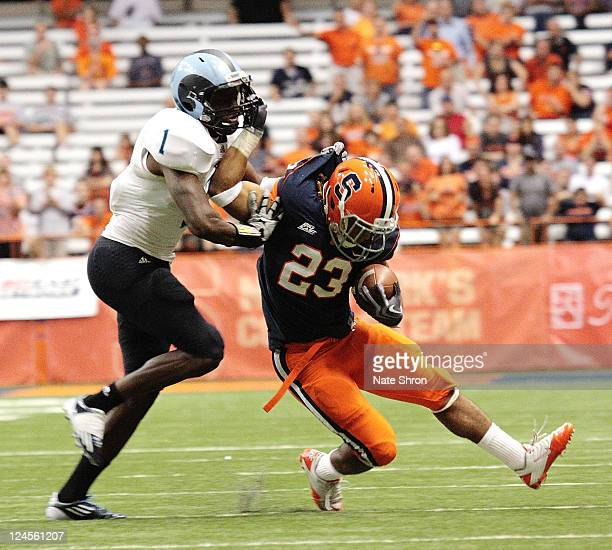 PrinceTyson Gulley of the Syracuse Orange fights off Rhode Island Rams player Darrell Dulany during the game on September 10 2011 at the Carrier Dome...