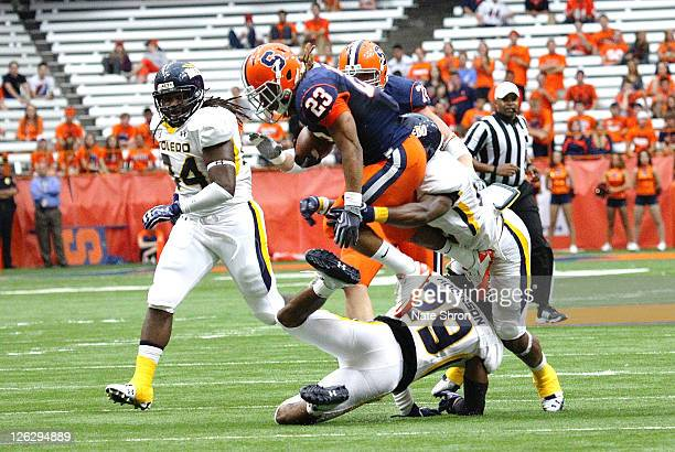 Prince-Tyson Gulley of the Syracuse Orange hurdles over Toledo Rockets' player Jermaine Robinson during the game on September 24, 2011 at the Carrier...