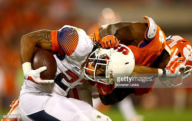 PrinceTyson Gulley of the Syracuse Orange is tackled by Tony Steward of the Clemson Tigers during their game at Memorial Stadium on October 25 2014...