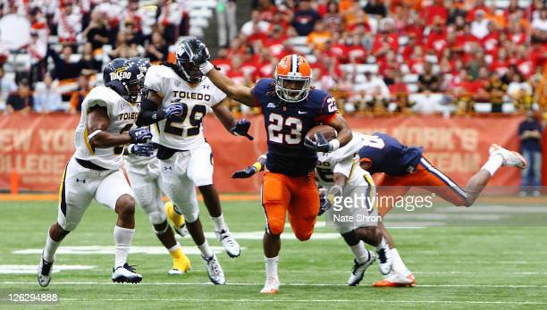 Prince-Tyson Gulley of the Syracuse Orange runs the ball while being chased by Toledo Rockets' player Jermaine Robinson during the game on September...