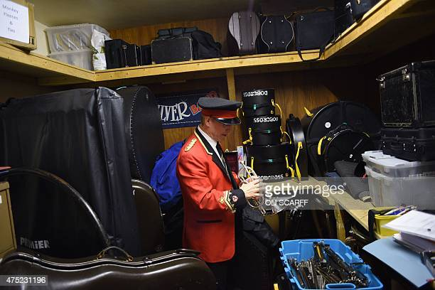Principal cornet for the Dobcross Silver Band checks his instrument in the band room before competing in Whit Friday brass band competitions in the...
