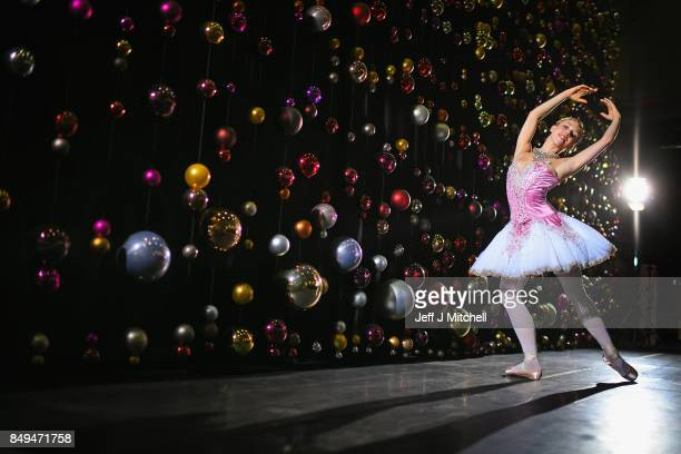 Principal dancer Constance Devernay dressed in the sugar plum fairy costume poses against a backdrop of Christmas baubles at the Tramway on September...