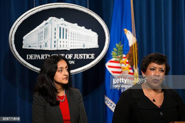 Principal Deputy Assistant Attorney General Vanita Gupta, head of the Justice Department's Civil Rights Division, looks on as U.S. Attorney General...