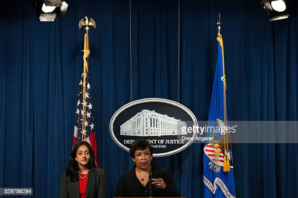 Principal Deputy Assistant Attorney General Vanita Gupta head of the Justice Department's Civil Rights Division looks on as US Attorney General...