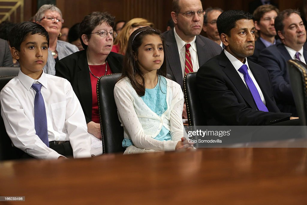 Principal Deputy Solicitor General of the United States Srikanth Srinivasan (R) and his children, twins Vikram and Maya Srinivasan, 11, listen to members of the Senate Judiciary Committee deliver opening remarks on Capitol Hill April 10, 2013 in Washington, DC. U.S. President Barack Obama has nominated Sirnivasan to be circuit judge for the United States Court of Appeals for the District of Columbia Circuit. A significant number of Supreme Court appointees were previously D.C. Circuit Court judges.