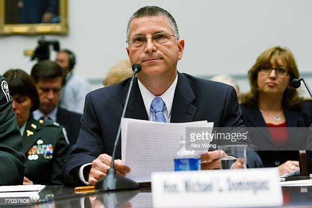 Principal Deputy Under Secretary of Defense Michael Dominguez listens as he testifies during a hearing before the National Security and Foreign...