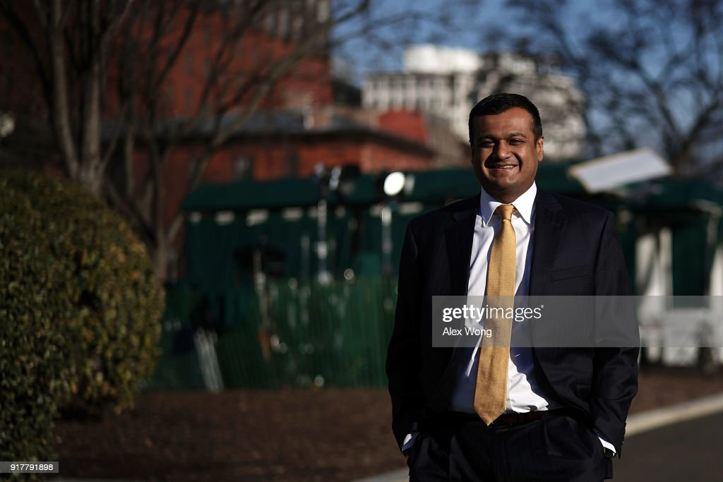 Principal Deputy White House Press Secretary Raj Shah on his way back to the West Wing after a TV interview at the White House February 13, 2018 in Washington, DC.