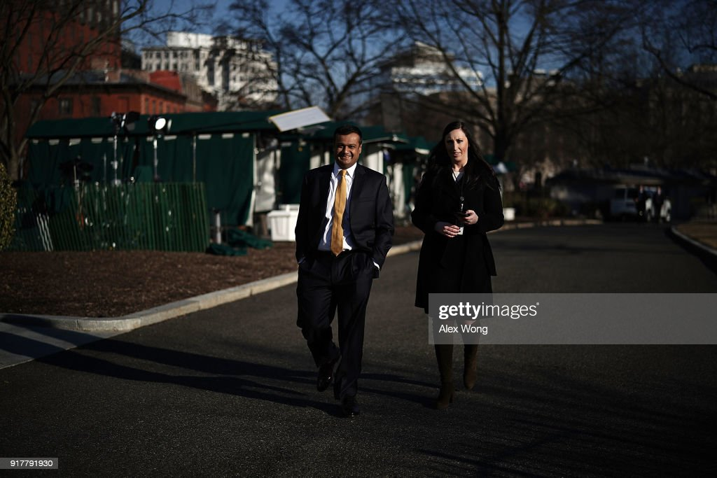 Principal Deputy White House Press Secretary Raj Shah (L) on his way back to the West Wing after a TV interview at the White House February 13, 2018 in Washington, DC.