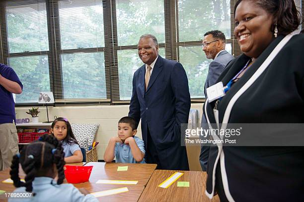 BLADENSBURG MD Principal Dr Judith Williams right Dr Segun C Eubank Prince George's County Board of Education Chair middle right and Rushern L Baker...