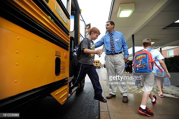 Principal James Orichosky greets children as they come off the buses Tuesday September 4 as the first day of school at Wingate elementary in the Bald...