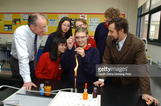 Principal John Taylor and science teacher Andre Casson with a class at Dulwich College, Pudong, Shanghai. 30 December 2004