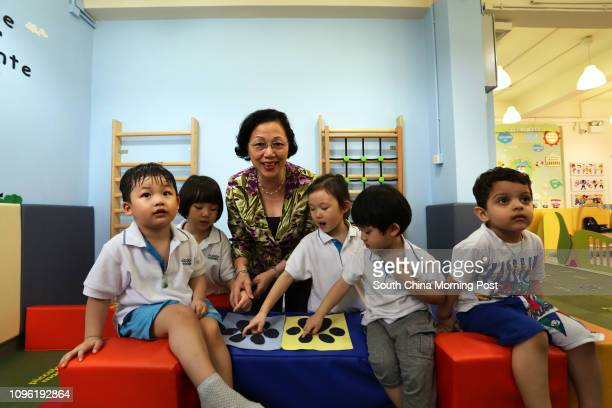 Principal Mary Tong Siufun President of the Hong Kong Kindergarten Association with kids Lucas Chan Amy Cao Michelle Ho Morris Ho and Vivaan from...