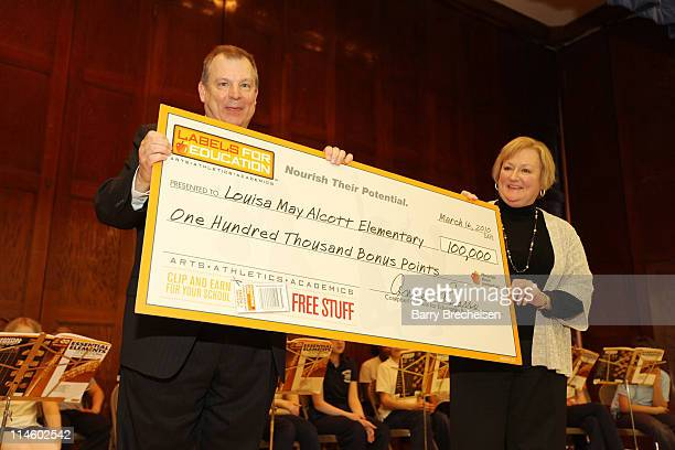 Principal of Alcott Elementary David Domovic and Campbell Soup Company Labels for Education Director Anne Pizarro Sagel hold up the check at the...