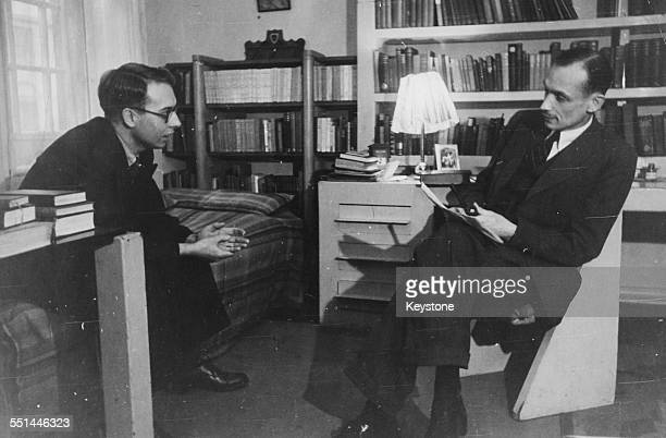 Principal of Ruskin College Lionel Elvin discussing essays with student Ernest Fisher in his office Oxford University circa 1945