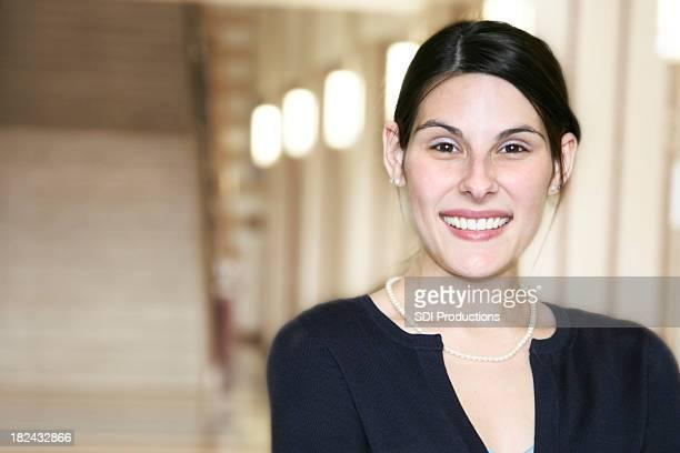 Principal or Teacher Smiling in School Hallway