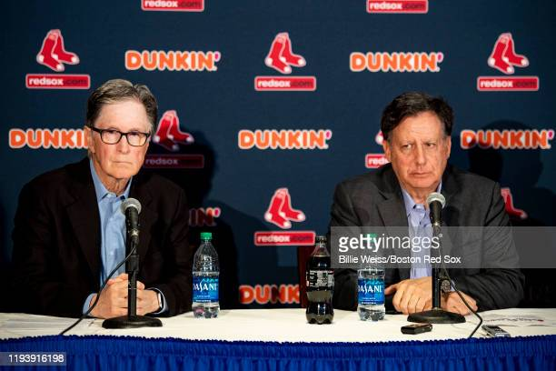 Principal owner John Henry and Chairman Tom Werner of the Boston Red Sox address the media during a press conference addressing the departure of...