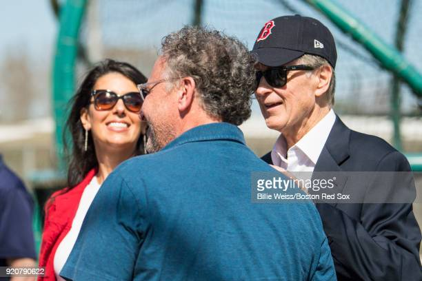 Principal Owner John Henry and his wife Linda Pizzuti Henry and President CEO Sam Kennedy of the Boston Red Sox talk during a team workout on...