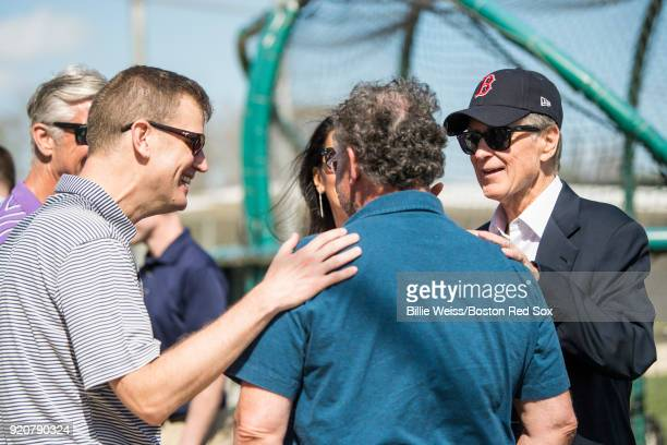 Principal Owner John Henry and President CEO Sam Kennedy of the Boston Red Sox talk during a team workout on February 19 2018 at jetBlue Park at...