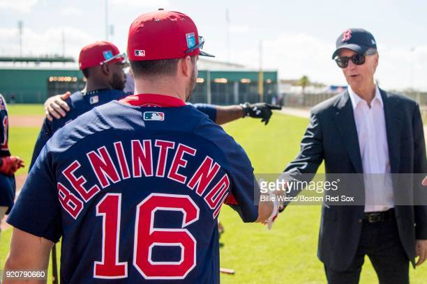 Principal Owner John Henry greets Andrew Benintendi of the Boston Red Sox during a team workout on February 19 2018 at jetBlue Park at Fenway South...