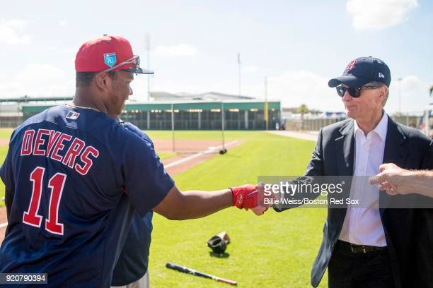 Principal Owner John Henry greets Rafael Devers of the Boston Red Sox during a team workout on February 19 2018 at jetBlue Park at Fenway South in...