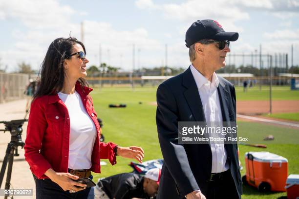 Principal Owner John Henry of the Boston Red Sox and his wife Linda Pizzuti Henry walk on the field during a team workout on February 19 2018 at...