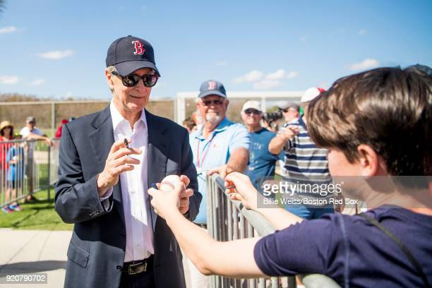 Principal Owner John Henry of the Boston Red Sox signs autographs for fans during a team workout on February 19 2018 at jetBlue Park at Fenway South...