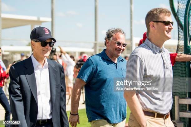 Principal Owner John Henry Partner David Ginsberg and President CEO Sam Kennedy of the Boston Red Sox walk on the field during a team workout on...