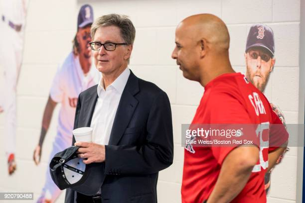 Principal Owner John Henry speaks with manager Alex Cora of the Boston Red Sox at a team meeting before a team workout on February 19 2018 at jetBlue...