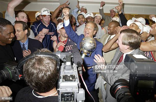 Principal Owner of the New Jersey Nets Lewis Katz celebrates receiving the Eastern Conference Championship Trophy along with the team after they...