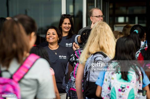 Principal Renee Dawson greets students on the first day of classes at the newly opened Brambleton Middle School on Thursday August 24 2017 in Ashburn...