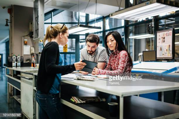 print factory workers having discussion - printing plant stock pictures, royalty-free photos & images