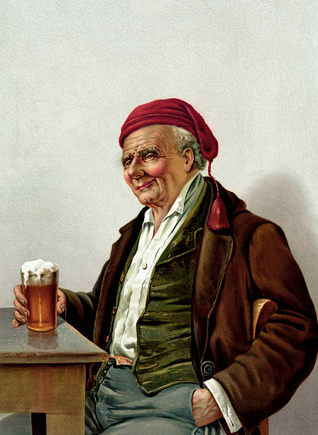 Old Man With A Beer At A Pub