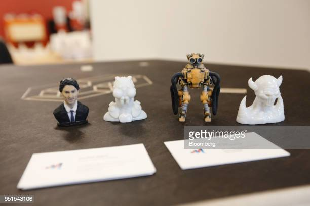 A 3D print of Justin Trudeau Canada's prime minister left sits next to other models at the Bayview Yards innovation center in Ottawa Ontario Canada...