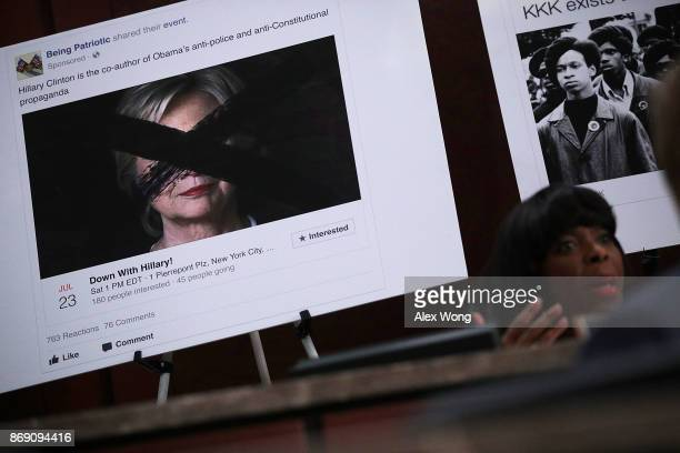 A print out of a social media post targeting former Democratic presidential candidate Hillary Clinton is on display as Rep Terri Sewell speaks during...