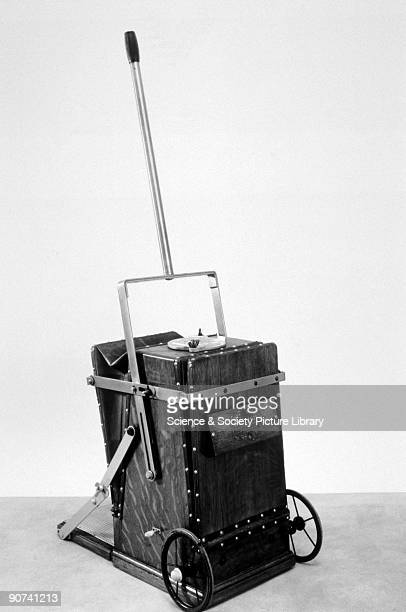 Print showing a BVC handoperated vacuum cleaner with one tube and suction nozzle The British Vacuum Cleaner Company was founded in 1900 by Henry...