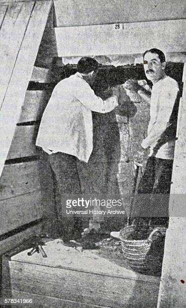 Print showing Howard Carter and George Herbert 5th Earl of Carnarvon discovering Tutankhamen's tomb Howard Carter an English archaeologist and...