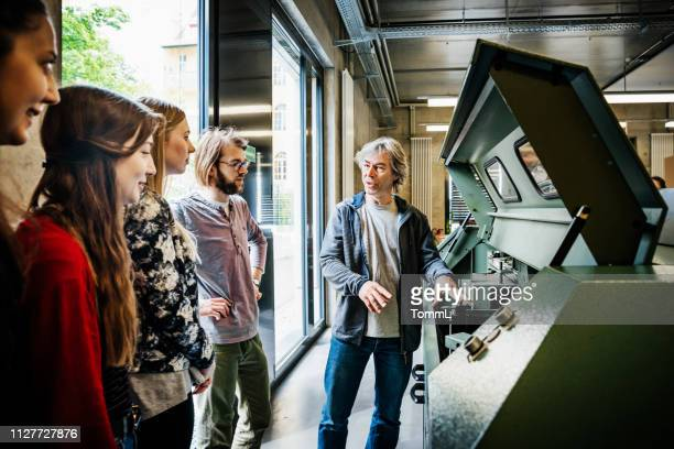 print technician explaining machinery to students - day stock pictures, royalty-free photos & images