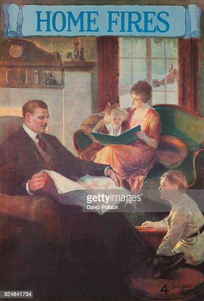 Printed by National Service Bureau happy family sits beside a roaring fire dad reads a newspaper as mom reads a book to young daugter