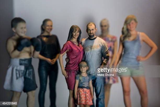 Printed figurines stand on display at the 3D gang company on August 26 2014 in Prague Czech Republic The 3D scanner is the largest in continental...