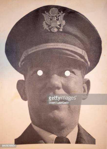 Printed mask with cut out eyeholes of United States Army solider William Calley, convicted of murdering 22 Vietnamese civilians in the My Lai...