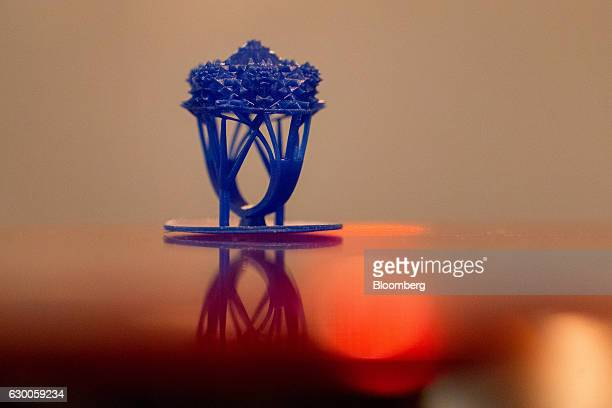 A 3D printed mold for a jewelry ring sits on a desktop inside the offices of 3D printing and design company Formlabs GmbH in Berlin Germany on...